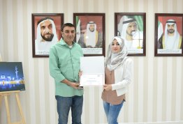 AAU President honored student Baraa Turkmany for her excellency in the Achievement Exam